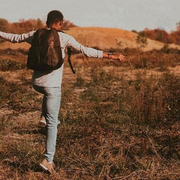 Male Instagram Influencer Skipping Through a Field